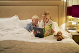 Kids reading bedtime story at the Hotel Baur au Lac, Zurich Switzerland