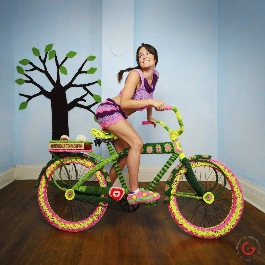 She never got to riding that flashy bike in the sun, so she crocheted a sunny day. The yarny breeze felt like living.
