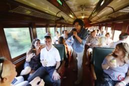Comedian Troy Gittings Works the Crowd in the Sanderson's Train Car