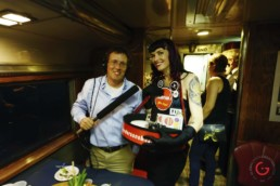 The Sanderson's Girl poses with KUAF's Kyle Kellams on the Art Train