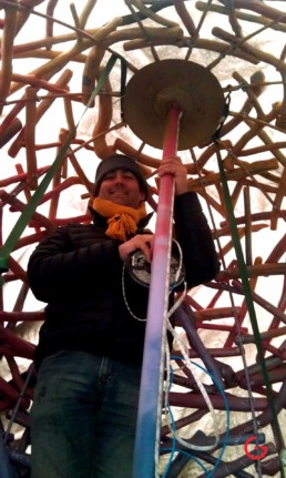 Jeremy Mason McGraw Wiring up The LED Lighting Inside of The Snow Covered Sphere Sculpture