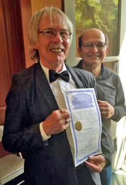 Eureka Springs, Arkansans Artist Zeek Taylor and Dick Titus hold marriage certificate in Eureka Springs Arkansas.