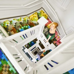 Couple returning to hotel room on colorful staircase - Professional Photographer Lifestyle Photography Wardrobe Stylist