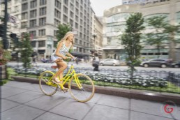 Girl Rides Bike Downtown - Photographer Lifestyle Photography Wardrobe Stylist