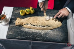 Salt encrusted fish preparing to be served at fine dining restaurant - Photographer Lifestyle Photography Wardrobe Stylist