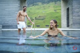 Romantic Couple Plays in the Pool at 7132 Hotel Therme - Professional Photographer Lifestyle Photography Wardrobe Stylist