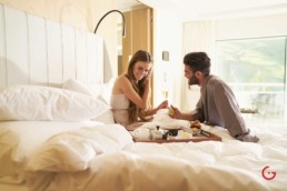 Romantic couple enjoys breakfast in bed at 7132 Hotel in Vals - Professional Photographer Lifestyle Photography Wardrobe Stylist