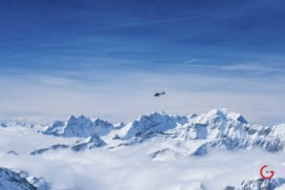 Private Helicopter Flies Over Snow Covered Swiss Alps - Professional Photographer Lifestyle Photography Wardrobe Stylist