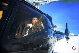 Woman arrives to ski slopes in private helicopter - Photographer Lifestyle Photography Wardrobe Stylist