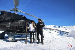 Couple arrives for ski trip in private helicopter - Professional Photographer Lifestyle Photography Wardrobe Stylist