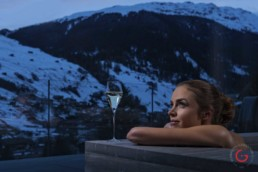 Woman enjoys a warm bath with a winter view at 7132 Hotel in Vals - Professional Photographer Lifestyle Photography Wardrobe Stylist