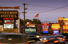 Hwy 76, Branson Strip at sunset looking east with blurred cars on driving past. - Advertising photographers in branson Missouri, Branson Missouri photography