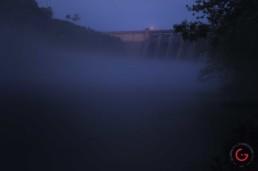 Dim morning light illuminates a ghostly table rock lake in morning fog. - Advertising photographers in Branson Missouri, Branson Missouri photography