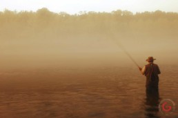 Man fishing on a cold morning near the fish hatchery of Lake Tanycomo. - Advertising photographers in Branson Missouri, Branson Missouri photography