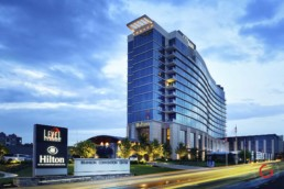 Branson Hilton Hotel at Twilight under a blue partially cloudy sky. - Advertising photographers in Branson Missouri, Branson Missouri photography