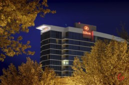 Branson Hilton Convention Center Hotel framed by fall leaves in the night sky. - Advertising photographers in Branson Missouri, Branson Missouri photography