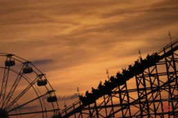 Riders anticipate the first drop on a roller-coaster at Cerebration City in the sunset. - Advertising photographers in Branson Missouri, Branson Missouri photography
