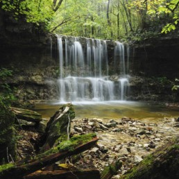A waterfall comes to life on the Henning Trail in Branson, mo. - Advertising photographers in Branson Missouri, Branson Missouri photography