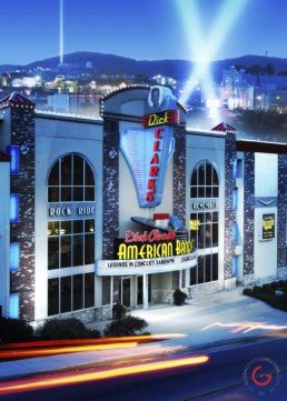 Dick Clark's American Bandstand Theater hosting legends in concert. Beams of light fill the sky in a Classic Hollywood portrait of Branson.