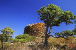 Nuraghe Under a Vivid Blue Sky, Sardinia, Italy - Travel Photographer of Italy Photoshoots, Italy Photography