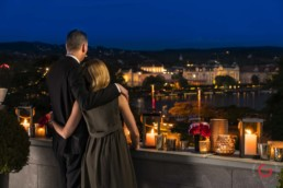 Couple have a romantic meal on the roof of the Baur au Lac - Travel Photographer and Switzerland Photography
