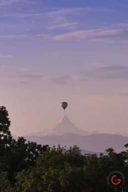 A balloon floats over the mountain view in Bern - Travel Photographer and Switzerland Photography
