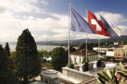 Flags on the Roof of the Baur au Lac - Travel Photographer and Switzerland Photography