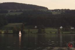Lone Sailboat on the Lake - Travel Photographer and Switzerland Photography