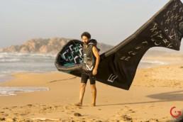Kitesurfer Renzo Mancini Walks on the Beach With His Kite
